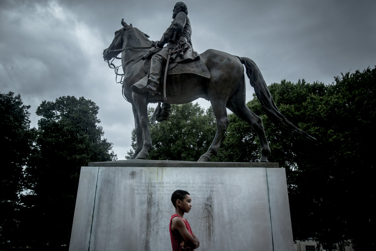 MEMPHIS, TN – July 2, 2015: Story is about a call to move a statue and grave of Nathan Bedford Forrest in Memphis. He and his wife and his great-grandson are buried in a park near downtown Memphis. The park was named for him. But it was renamed in 2013. The bodies and the statue of him are still there, though. In the days after the Charleston shooting, the mayor and city council have renewed their efforts to get the bodies and statue moved back to the cemetery where they were originally buried. Credit: Andrea Morales for The New York Times